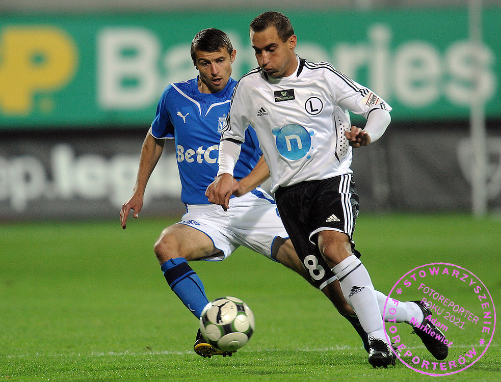 (L) TOMASZ BANDROWSKI (LECH POZNAN) & (R) MACIEJ IWANSKI (LEGIA) FIGHT FOR THE BALL DURING EXTRALEAGUE SOCCER MATCH BETWEEN LEGIA WARSAW AND LECH POZNAN DURING 8. ROUND SEASON 2009/2010...WARSAW , POLAND , SEPTEMBER 25, 2009..( PHOTO BY ADAM NURKIEWICZ / MEDIASPORT )..PICTURE ALSO AVAIBLE IN RAW OR TIFF FORMAT ON SPECIAL REQUEST.