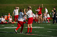 Kody Kitching gets a high five from Lexi Bladecki as well as cheers from his team on the sidelines as he scores a goal for the Laconia Unified Soccer team during their game with Winnisquam on Monday afternoon.  (Karen Bobotas/for the Laconia Daily Sun)