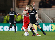 Adam Clayton of Middlesbrough and Leeds United midfielder Eunan O'Kane during the EFL Sky Bet Championship match between Middlesbrough and Leeds United at the Riverside Stadium, Middlesbrough, England on 2 March 2018. Picture by Paul Thompson.