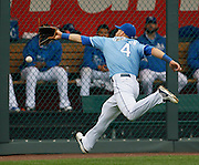 Kansas City Royals left fielder Alex Gordon is unable to catch a fly ball from Chicago White Sox' Hector Gimenez in the seventh inning of a baseball game at Kauffman Stadium in Kansas City, Mo., Sunday, May 5, 2013.  (AP Photo/Colin E. Braley).