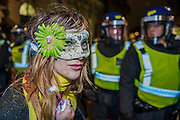 The march is briefly kettled - The annual Million Mask March bonfire night protest started in Trafalgar Square and headed to Westminster where it splintered. The march was organised by Anonymous UK and marchers wore the trademark V for Vendetta, Guy Fawkes masks. The police had placed tight restrictions on the route after trouble last year but, after a brief kettle, seemed happy to let the crowd filter in different directions.