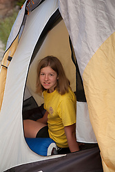 North America, United States, Colorado, Dinosaur National Monument, Green River (Gates of Lodore section),  girl (age 10) in yellow tent  MR