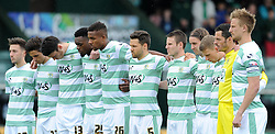 Yeovil Town players hold a minute silence to mark the Bradford fire anniversary. - Photo mandatory by-line: Harry Trump/JMP - Mobile: 07966 386802 - 25/04/15 - SPORT - FOOTBALL - Sky Bet League One - Yeovil Town v Port Vale - Huish Park, Yeovil, England.