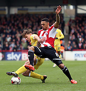 Andre Grey tackling Sid Nelson during the Sky Bet Championship match between Brentford and Millwall at Griffin Park, London, England on 21 March 2015. Photo by Matthew Redman.