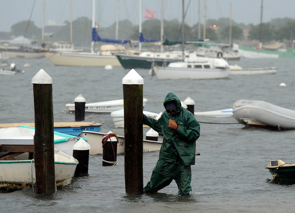 Tony Blonshine negotiates a sunken dock along the wateraaØs edge at the Davis Island Marina as heavy rain falls Sunday, June 24, 2012 in Tampa. Hard rain and wind pelted the Tampa Bay area Sunday as Tropical Storm Debbie headed toward the coast of Louisiana.