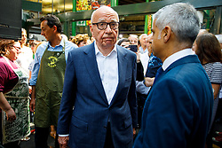 © Licensed to London News Pictures. 14/06/2017. London, UK. Owner of News Corp UK, RUPERT MURDOCH and Mayor of London SADIQ KHAN attend the reopening of Borough Market in London as it reopens on 14 June 2017, following a terror attack that killed 8 people over a week ago. Photo credit: Tolga Akmen/LNP