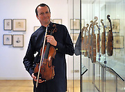 ©London News pictures. 09/03/11. One of the rarest musical instruments in the world, the Stradivarius Archinto viola played by international soloist Philip Dukes today (09/03/11). Dating from 1696, the viola is one of only ten made by the master instrument-maker, of which only eight remain and of which only two are playable. The Archinto, part of the Royal Academy of Music collection, is now rarely played in public concerts. Philip Dukes, a regular teacher at the Royal Academy of Music, will be re-acquainting himself with the instrument ahead of his 20th anniversary recital with Julian Lloyd-Webber and pianist Piers Lane at London's Southbank Centre. Picture Credit should read Stephen Simpson/LNP
