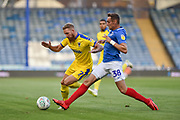 AFC Wimbledon Midfielder, Scott Wagstaff (7) and Portsmouth Defender, Brandon Haunstrup (38) during the Carabao Cup match between Portsmouth and AFC Wimbledon at Fratton Park, Portsmouth, England on 14 August 2018.