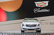Manhattan, New York, USA. April 12, 2017.  2017 White Cadillac Touring 6, CT6, is on display at the New York International Auto Show, NYIAS, during the first Press Day at the Javits Center. Cadillac emblem is projected on background.