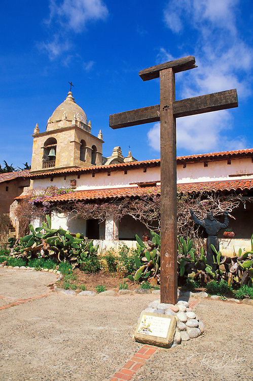 Wooden cross and Father Serra statue in the main courtyard at Mission San Carlos Borromeo de Carmelo (2nd California Mission), Carmel, California