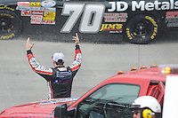 MAR 16, 2013; Bristol, TN, USA; NASCAR Nationwide Series driver Nationwide Series driver Hal Martin (44) expresses his frustration with driver Brad Teague (70) after Martin crashed during the Grit Chips 300 Race at Bristol Motor Speedway. Nationwide Series driver Kyle Busch (54) won the race. Mandatory Credit: Randy Sartin-USA TODAY Sports