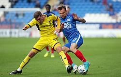 Danny Lloyd of Peterborough United tackled Joe Rothwell of Oxford United - Mandatory by-line: Joe Dent/JMP - 30/09/2017 - FOOTBALL - ABAX Stadium - Peterborough, England - Peterborough United v Oxford United - Sky Bet League One