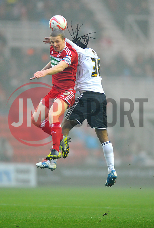 Middlesbrough's Grant Leadbitter battles for the high ball with Bristol City's Neil Danns - Photo mandatory by-line: Joe Meredith/JMP  - Tel: Mobile:07966 386802 24/11/2012 - Middlesbrough v Bristol City - SPORT - FOOTBALL - Championship -  Middlesbrough  - River Side Stadium