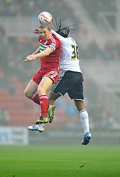 Middlesbrough's Grant Leadbitter battles for the high ball with Bristol City's Neil Danns - Photo mandatory by-line: Joe Meredith/JMP  - Tel: Mobile:07966 386802 24/11/2012 - Middlesbrough v Bristol City - SPORT - FOOTBALL - Championship -  Middlesbrough  - River Side Stadium