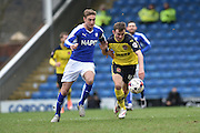Thomas Grant (42) of Fleetwood Town and Garry Liddle (5) of Chesterfield FC  during the Sky Bet League 1 match between Chesterfield and Fleetwood Town at the b2net stadium, Chesterfield, England on 26 March 2016. Photo by Ian Lyall.