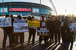 As a small group of Sikh  protesters demonstrate outside Wembley Stadium, thousands of the UK's Indian community stream into the stadium ahead of an address to more than 60,000 by Indian Prime Minister Narendra Modi at a 'UK Welcomes Modi' reception. With more than 9 billion worth of trade deals signed during his visit, the euphoria is tempered by the fact that just a few years ago he was a persona non grata in the UK. Modi, a Hindu and his BJP party are accused of a wide range of human rights abuses against religious and ethnic minorities in India. PICTURED: A small group of Sikh protesters gathered outside the stadium.©2015 Paul Davey. All rights reserved.   // Licensing: Please contact Paul Davey paul@pauldaveycreative.co.uk Tel +44 (0) 7966 016 296 or +44 (0) 208 969 6875.