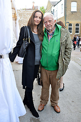 DAVID BAILEY and CATHERINE BAILEY at a private view in aid of Chickenshed of Julian Schnabel's first UK solo show of paintings for 15 years entitled 'Every Angel Has A Dark Side' held at the Dairy Art Centre, 7a Wakefield Street, Bloomsbury, London on 24th April 2014.