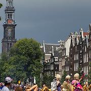 NLD/Amsterdam/20120804 - Canalparade tijdens de Gaypride 2012, donkere wolken, regen, westertoren