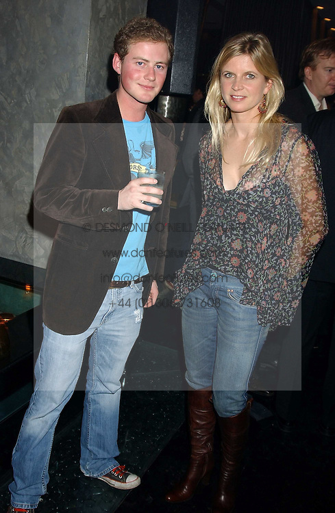 GUY PELLY and the MARCHIONESS OF MILFORD HAVEN at a party to celebrate the publication of Tatler's Little Black Book 2005 held at the Baglioni Hotel, 60 Hyde Park Gate, London SW7 on 9th November 2005.<br /><br />NON EXCLUSIVE - WORLD RIGHTS