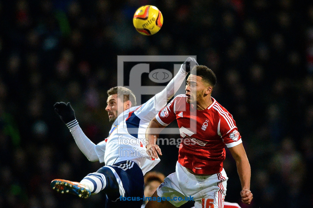 Picture by Ian Wadkins/Focus Images Ltd +44 7877 568959<br /> 11/01/2014<br /> Andr&eacute; Moritz of Bolton Wanderers (left) and Jamaal Lascelles of Nottingham Forest during the Sky Bet Championship match at the Reebok Stadium, Bolton.