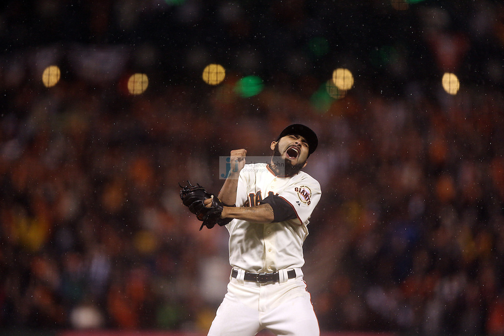 Sergio Romo of the San Francisco Giants and the St. Louis Cardinals during Game Seven of the National League Championship Series at AT&T Park on October 22, 2012 in San Francisco, California.  (photo by Jed Jacobsohn)