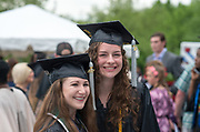 Friends Danielle Valaitis (Left) and Kate Pellegrini pose for a photo together following undergraduate commencement ceremonies. Photo by Ben Wirtz Siegel