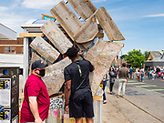 """12 JUNE 2020 - MINNEAPOLIS, MINNESOTA: A signs a fist that is the logo of Black Live Matter at the impromptu memorial for George Floyd at the corner of 38th Street and Chicago Ave. in Minneapolis. The intersection is informally known as """"George Floyd Square"""" and is considered a """"police free zone."""" There are memorials to honor Black people killed by police and people providing free food at the intersection. Floyd, an unarmed Black man, was killed by Minneapolis police on May 25 when an officer kneeled on his neck for 8 minutes and 46 seconds. Floyd's death sparked weeks of ongoing protests and uprisings against police violence around the world.          PHOTO BY JACK KURTZ"""
