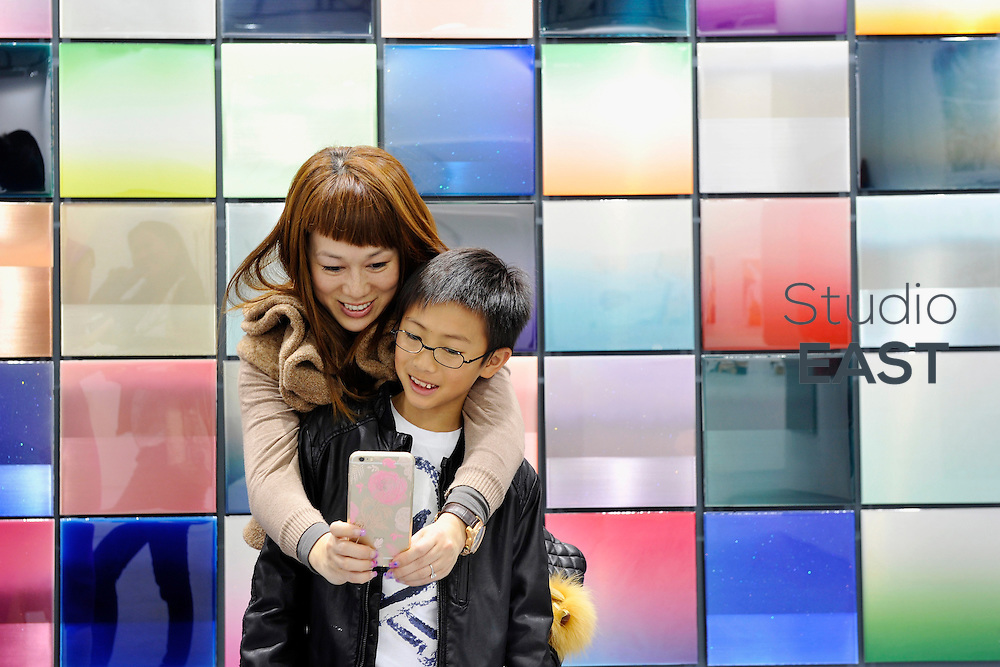 HONG KONG - MARCH 13: Visitors take a selfie picture of themselves in front of a colorful art piece  in art fair Art Central on its first day on March 13, 2015 in Hong Kong, Hong Kong.  (Photo by Lucas Schifres/Getty Images)