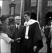 04/07/1963<br /> 07/04/1963<br /> 04 July 1963<br /> Degree day at Trinity College Dublin. Mr William L. Haslett (right) of 38 Ardenlee Gardens, Ravenhill Road, Belfast, who received the degree B.A. at the conferring at TCD being congratulated by his parents Mr and Mrs William Haslett after the conferring.
