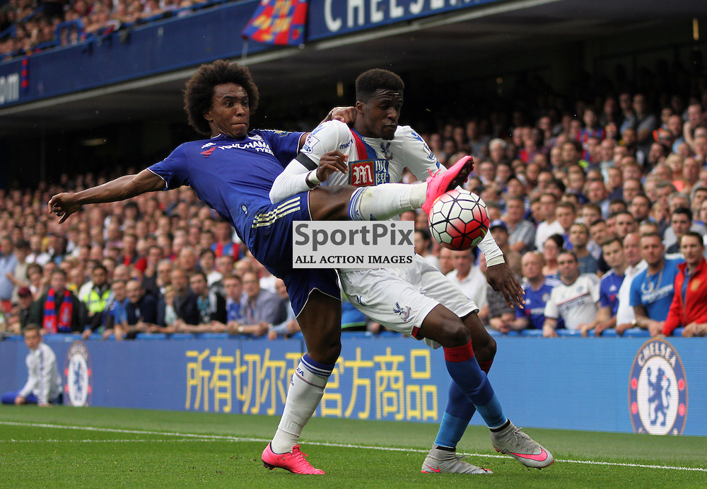 Wilfried Zaha protects the ball from Willian During Chelsea vs Crystal Palace on Saturday the 29th August 2015