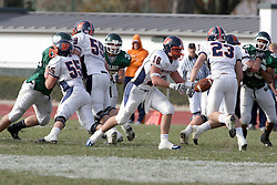 10 November 2007:  Kyle Bradley extends the ball to Dan Newman. This game between the Wheaton College Thunder and the Illinois Wesleyan University Titans was for a share of the CCIW Championship and was played at Wilder Field on the campus of Illinois Wesleyan University in Bloomington Illinois.