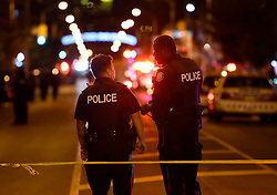 Police work at the scene of a mass casualty incident in Toronto, ON, Canada on Sunday, July 22, 2018. A young woman has been killed and 13 others injured in a shooting incident in Toronto, Canadian police say. The Sunday night shooting happened in the Danforth and Logan avenues area. The gunman died in an exchange of fire. Among those injured is a young girl, described as in a critical condition. Police are appealing for witnesses. Photo by Nathan Denette/ABACAPRESS.COM