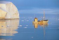 Fishing Boat on Ocean by Iceberg