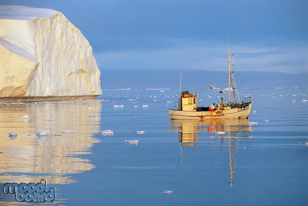 Fishing Boat on Ocean by Iceberg