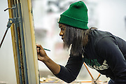 Ohio University student D. Mynha Daniels paints in Seigfred Hall on Sunday, December 2, 2012.  (© Brien Vincent)
