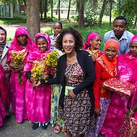 Belatchachew celebrates with the 2015 graduates.