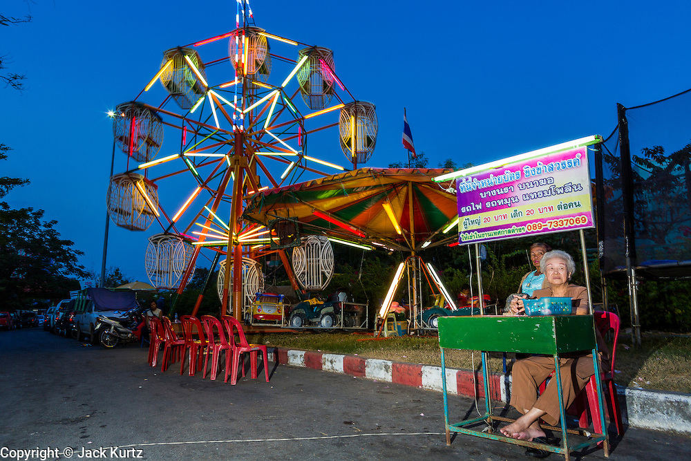 09 FEBRUARY 2014 - HAT YAI, SONGKHLA, THAILAND: Some of the midway rides at the street fair during Lunar New Year in Hat Yai. Hat Yai was originally settled by Chinese immigrants and still has a large ethnic Chinese population. Chinese holidays, especially Lunar New Year (Tet) and the Vegetarian Festival are important citywide holidays.     PHOTO BY JACK KURTZ