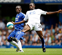 Photo: Richard Lane/Sportsbeat Images. <br />Chelsea v Birmingham. Barclay's Premiership. 12/08/2007. <br />Chelsea's Michael Essien and Birmngham's Fabrice Muamba challenge for the ball.