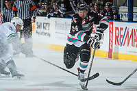 KELOWNA, CANADA - NOVEMBER 25: Tyson Baillie #24 of Kelowna Rockets jumps over the stick of Scott Eansor #8 of Seattle Thunderbirds during first period on November 25, 2015 at Prospera Place in Kelowna, British Columbia, Canada.  (Photo by Marissa Baecker/Getty Images)  *** Local Caption *** Scott Eansor; Tyson Baillie;