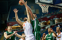 Jorge Garbajosa of Spain between Uros Slokar of Slovenia and Primoz Brezec of Slovenia during the fifth-place basketball match between National teams of Slovenia and Spain at 2010 FIBA World Championships on September 10, 2010 at the Sinan Erdem Dome in Istanbul, Turkey.   (Photo By Vid Ponikvar / Sportida.com)