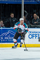 KELOWNA, CANADA - APRIL 14: Devante Stephens #21 of the Kelowna Rockets skates with the puck from behind the net against the Portland Winterhawks on April 14, 2017 at Prospera Place in Kelowna, British Columbia, Canada.  (Photo by Marissa Baecker/Shoot the Breeze)  *** Local Caption ***