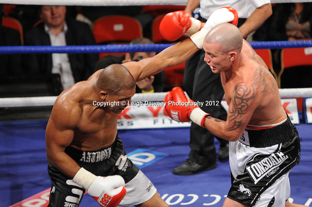 Travis Dickinson (white/grey shorts) defeats John Anthony in a Cruiserweight contest at The Winter Gardens, Blackpool on the 31st March 2012. Frank Maloney and Steve Wood VIP Promotions. © Leigh Dawney Photography 2012.