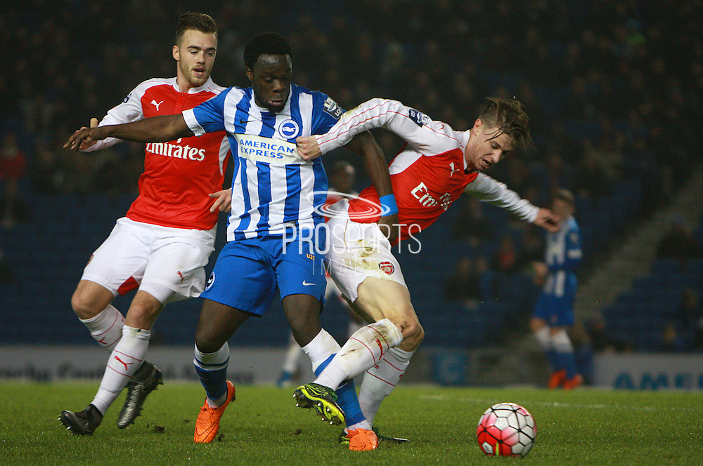 Brighton striker Elvis Manu & Arsenal midfielder Ben Sheaf tussle for possession during the Barclays U21 Premier League match between Brighton U21 and Arsenal U21 at the American Express Community Stadium, Brighton and Hove, England on 30 November 2015. Photo by Bennett Dean.