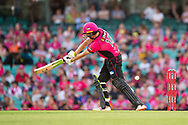 Sydney Sixers player Daniel Hughes misses the ball at the Big Bash League cricket match between Sydney Sixers and Melbourne Stars at The Sydney Cricket Ground in Sydney, Australia
