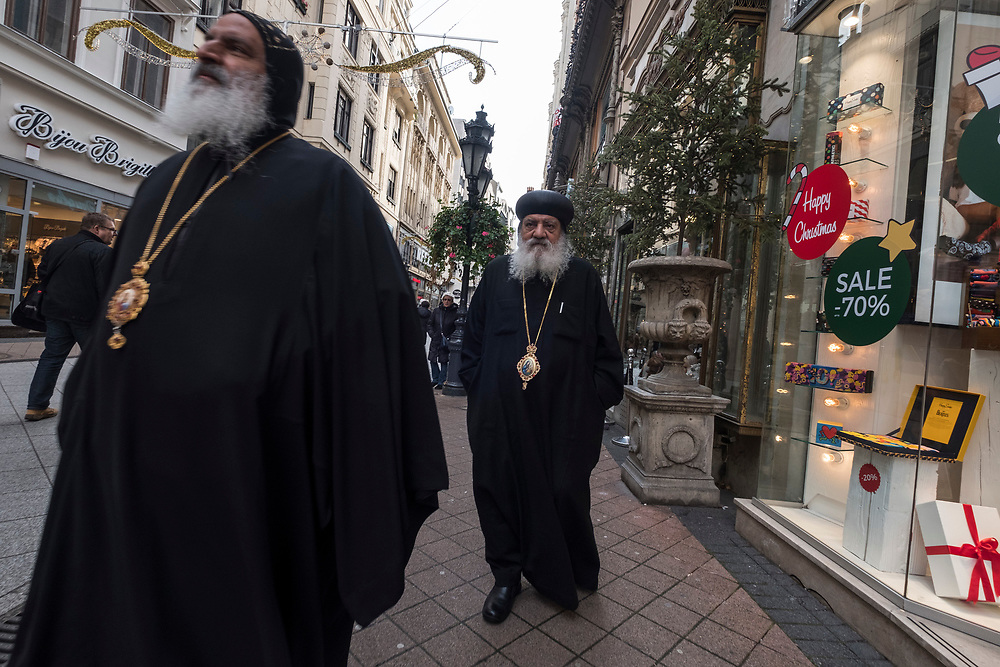 BUDAPEST, HUNGARY - DECEMBER 07:  Two Orthodox priests walk along Vaci utca on December 7, 2017 in Budapest, Hungary. The traditional Christmas market and lights will stay until 31st December 2017.  (Photo by Awakening/Getty Images)