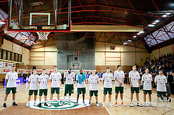 Players of Union Olimpija listening to the national anthem during basketball match between KK Helios Domzale and KK Union Olimpija in Final of Spar Slovenian Cup, on February 13, 2011 in Sportna dvorana Poden, Skofja Loka, Slovenia. (Photo By Vid Ponikvar / Sportida.com)