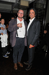 Left to right, FERGUS HENDERSON and GIORGIO LOCATELLI at a party to celebrate the publication of 'Made In Sicily' by Giorgio Locatelli at Locanda Locatelli, Seymour Street, London on 4th October 2011.
