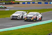 side by side out of the hairpin Daniel ROWBOTTOM Cataclean Racing with Ciceley Motorsport & Bobby THOMPSON GKR Scaffolding with Autobrite Direct head up the hill during the Kwikfit British Touring Car Championship at Knockhill Racing Circuit, Dunfermline, Scotland on 15 September 2019.