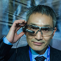 London, UK - 17 March 2014:  Susumu Izuura wears Vuzix glasses with a BarcodeEye app at the Wearable Technology Conference at Olympia in London