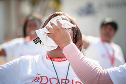 "Protestors demand better treatment for caregivers and health workers at the 2016 International AIDS Conference in Durban, South Africa, saying ""When health workers suffer, society suffers"". As part of the demonstration, protestors perform stunt where a person gets her tears forcefully wiped from her face using a white cloth."